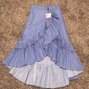 Small pinstriped high waisted ruffle skirt.